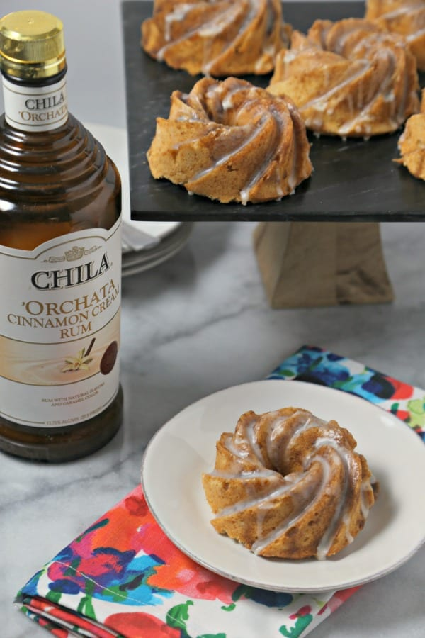 These Chila 'Orchata Mini Bundt Cakes from CookingInStilettos.com are a sweet treat with a bit of spirit. The perfect mini bundt cake has the flavors of Chila 'Orchata Cinnamon Cream Rum woven into every sweet bite. These mini cakes will be a hit at your next dinner party. | @CookInStilettos