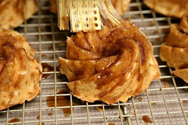 Chila 'Orchata Mini Bundt Cakes - Brushing on the Syrup | CookingInStilettos.com