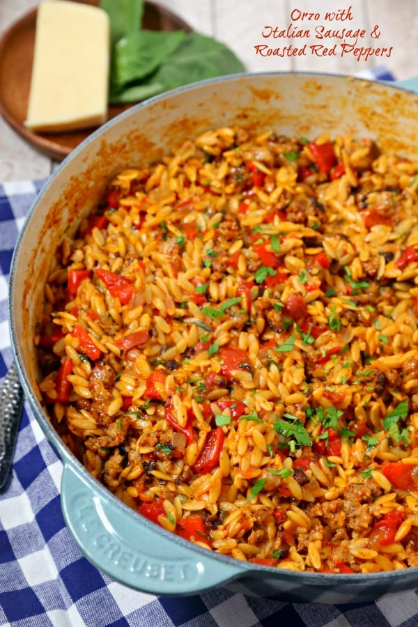 For easy weeknight dinners, make this savory Orzo with Italian Sausage and Roasted Red Peppers from CookingInStilettos.com. Dinner will be on the table in minutes with this easy one pan recipe! | One Pot Meal | Orzo Recipe | Easy Weeknight Dinner | 30 Minute Meals | Italian Sausage | Roasted Red Peppers | Fontina Cheese | Easy Comfort Food Recipe