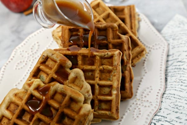 These delicious Apple Pancetta Waffles with Bourbon Cider Syrup from CookingInStilettos.com are the perfect meld of sweet and savory, with fluffy waffles studded with apples, toasted pecans and crisp pancetta and drizzled with a boozy apple cider syrup | @CookInStilettos | Apple Bacon Waffles | Homemade Waffles | Bourbon | Pancetta | Brunch Waffle Recipe | Savory Waffles | Easy Waffle Recipe
