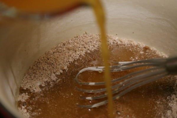 Apple Pancetta Waffles with Bourbon Cider Syrup - Making the Bourbon Cider Syrup | CookingInStilettos.com