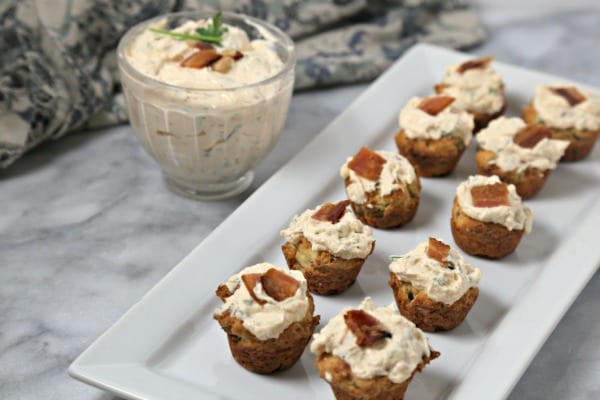 These bite-size Bacon Thyme Scones with Savory Whipped Ricotta from CookingInStilettos.com are a delicious bite for any party! Bacon and fresh thyme are baked into mini muffin scones with a herby cheesy whipped ricotta dolloped on top. What's not to love? | @CookInStilettos