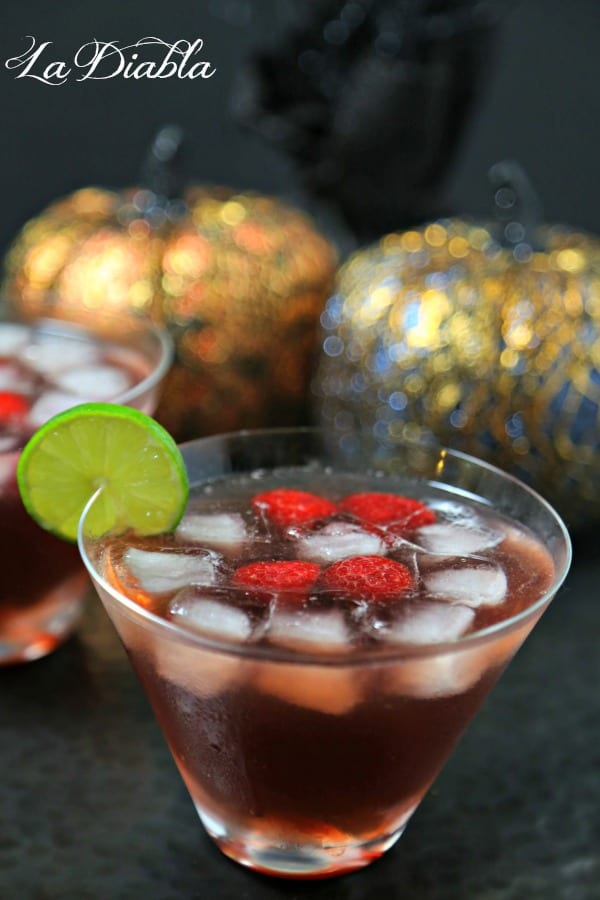 This La Diabla Cocktail from CookingInStilettos.com brings a bit of sass and bite to the party with the flavors of raspberry and pomegranate melded with tequila, lime and ginger for the perfect sip! | La Diabla Cocktail | Chambord Cocktail | Halloween | Easy Halloween Drink Recipe | Halloween Cocktail | Ginger Beer
