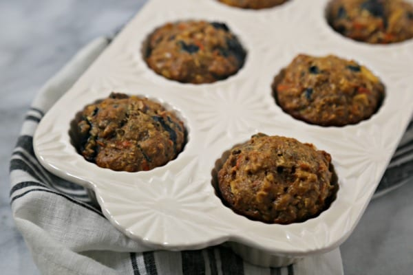 These Blueberry Morning Glory Muffins from CookingInStilettos.com are a delicious way to start the day. Plump blueberries are with carrots, apples, pecans and coconut for the ultimate blueberry muffin. Bake up a batch of these Blueberry Morning Glory Muffins for your next breakfast or brunch!
