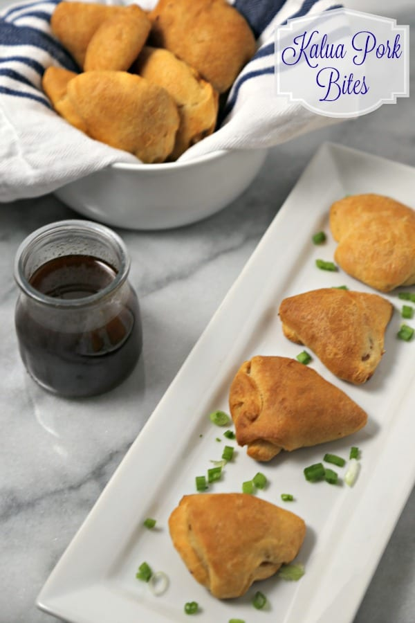 Kalua Pork Bites with Homemade Pineapple Teriyaki Sauce from CookingInStilettos.com will be a hit at your holiday party, packed with tender Kalua pork, pineapple and ginger, nestled in golden Pillsbury Crescents for the perfect party bite