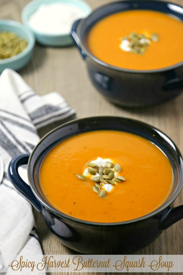 This velvety smooth Spicy Harvest Butternut Squash Soup from CookingInStilettos.com is packed with the flavors of autumn with fresh butternut squash, apple and pear with a hint of spicy heat! This delicious butternut squash soup recipe will be a holiday favorite and is so easy to make | @CookInStilettos