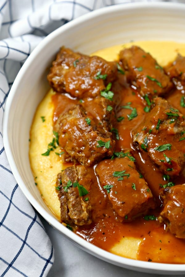Cinnamon Spiced Slow Cooker Short Ribs from CookingInStilettos.com are the ultimate autumn dish. Rich beef short ribs are simmered for hours in a silky cinnamon spiced broth with a secret ingredient. This is the perfect comfort food recipe and so easy to make!