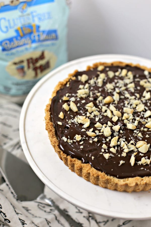 Gluten Free Chocolate Caramel Tart with Macadamia Nut Crust | CookingInStilettos.com