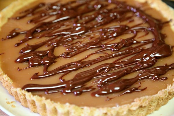 Gluten Free Chocolate Caramel Tart with Macadamia Nut Crust- Chocolate Ganache | CookingInStilettos.com