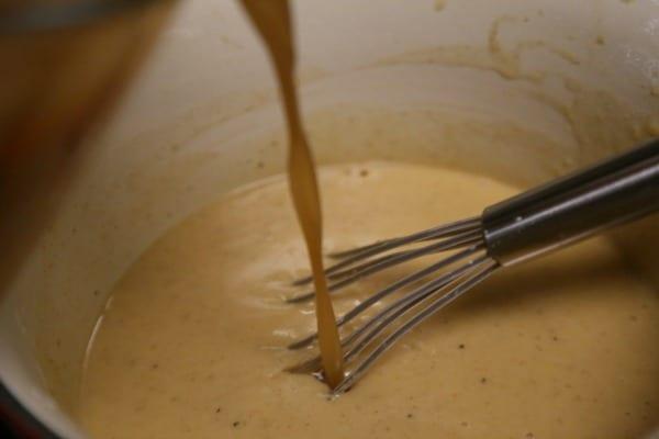 Mustard Maple Glazed Roast Turkey with Homemade Gravy- Whisking in the Pan Drippings   CookingInStilettos.com