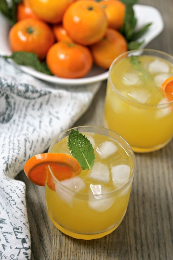 This Tangerine Mojito from CookingInStilettos.com is a citrusy twist on a classic mojito recipe. Fresh tangerine juice is muddled with rum, mint, and Tropicana Tangerine Lemonade for the perfect sunshine inspired cocktail, fabulous for last minute entertaining!