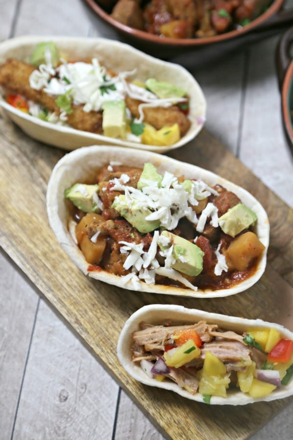 Kalua Pork Tacos with Pineapple Mango Salsa and a DIY Taco Bar for the Big Game from CookingInStilettos.com will be the hit of your party!