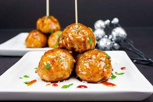 Delicious Dishes Recipe Party - Game Day Recipes - Firecracker Chicken Meatballs from Don't Sweat the Recipe | CookingInStilettos.com