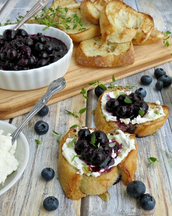 Delicious Dishes Recipe Party - Berry Recipes - Blueberry and Goat Cheese Crostini from 5 Minutes from Mom | CookingInStilettos.com