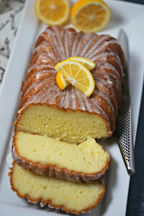 This Meyer Lemon Greek Yogurt Loaf with Vanilla Lemon Glaze from CookingInStilettos.com is a must for the brunch table. A cross between a quick bread and a pound cake, this moist and rich bread is packed with lemon flavor with a hint of vanilla and perfect slathered with jam or on its own. If you love the lemon loaf from the local coffee house, you are going to love this recipe. Lemon Loaf | Quick Bread | Loaf Cake | Vanilla | Brunch | Breakfast | Greek Yogurt Cake