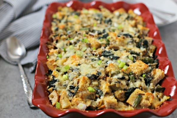This Spinach Artichoke and Asparagus Strata from CookingInStilettos.com is packed with layers of flavor, fresh veggies and sharp cheddar cheese - a make-ahead dish perfect for brunch! #BrunchWeek Strata | Breakfast | Brunch | Casserole | Make Ahead Recipe