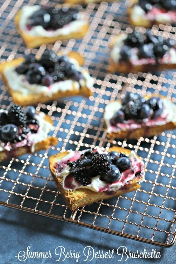 Summer Berry Dessert Bruschetta from CookingInStilettos.com is a sweet ending to a summer soiree with golden brioche dolloped with vanilla marscapone cream and sweet summer berries.  Dessert Bruschetta | Blueberries | Blackberries | Marscapone | Easy Summer Desserts
