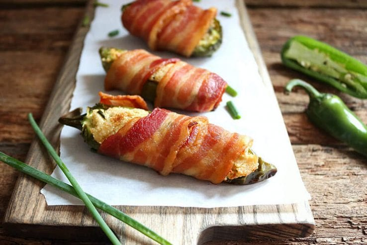 Bacon Wrapped Sweet Pepper Poppers are the perfect appetizer with sweet mini bell peppers stuffed with a cheesy herb filling wrapped in crispy bacon! Sweet Pepper Poppers | Bell Pepper Stuffed Poppers | Appetizers | Mini Bell Pepper Recipes | Bacon Recipes | Easy Entertaining Recipes